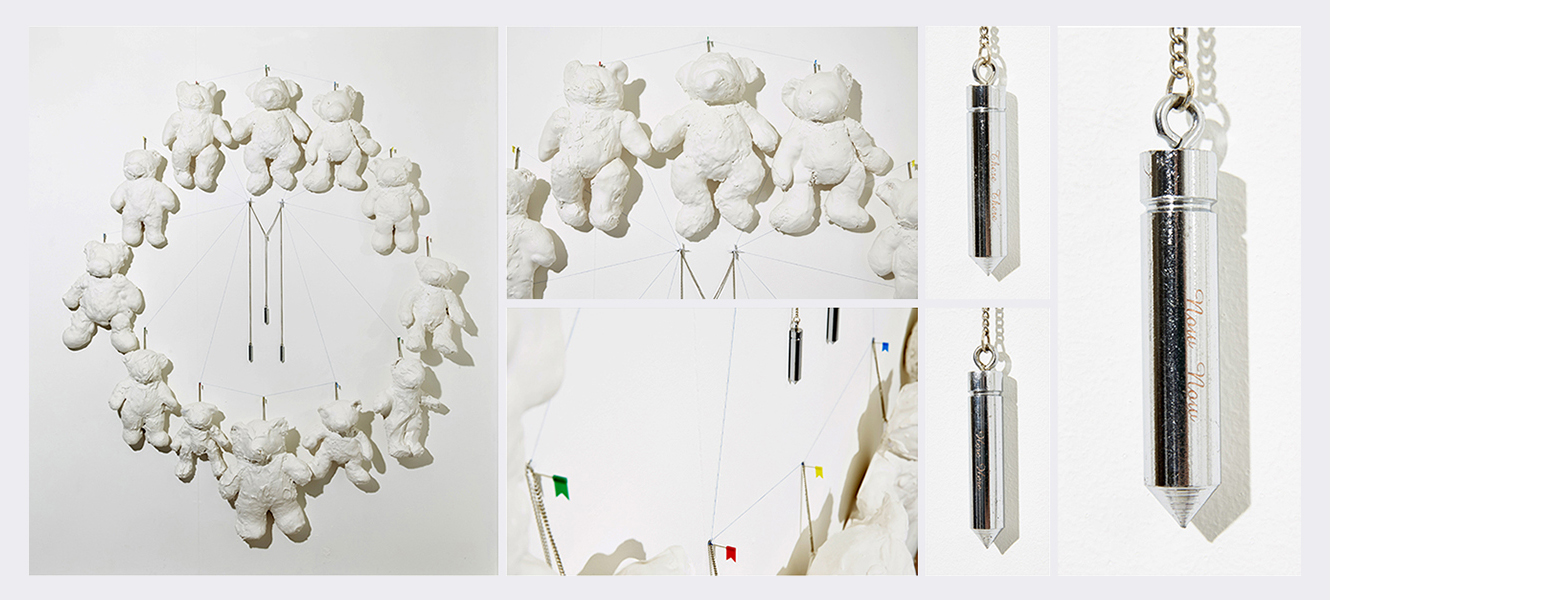 Here Here There There Now Now   /  That Was Then This Is Now  (2014)   (195cm x 168cm)   Teddy bears  /  plaster of Paris  /  engraved plumb weights  / mapping pins  /  thread  / chain.